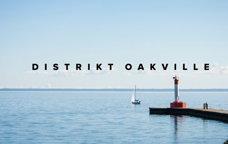 Distrikt Oakville text with Lake Ontario background