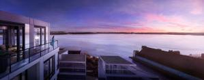 Rendering of Empire Quay House Condos suite terrace with vivid purple sunset sky.