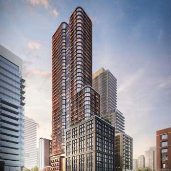 Four Eleven King Condos exterior with surrounding cityscape.