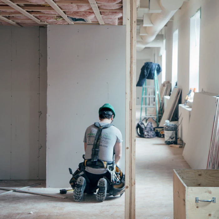 A person renovating a condominium unit.