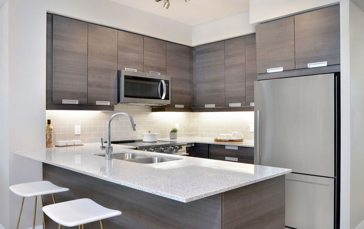 Interior rendering of Perla Towers condo suite kitchen.