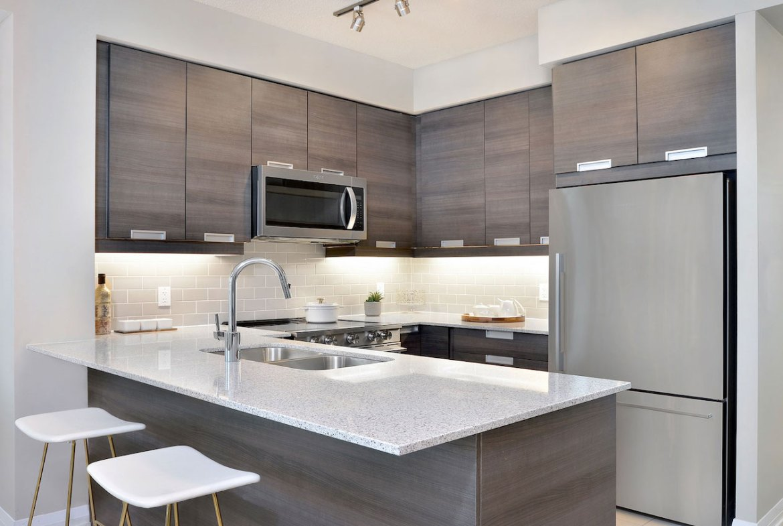 Interior rendering of Perla Towers condo suite kitchen.