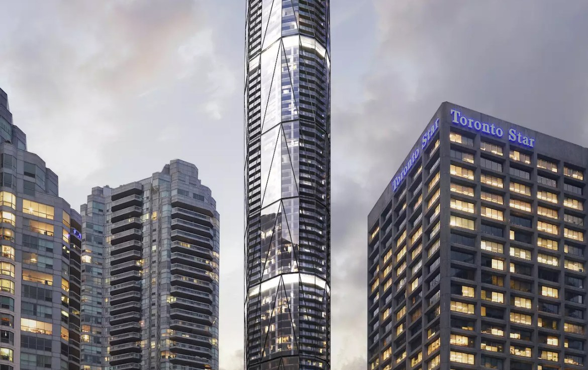 Sky Tower rendering of full condo at dusk near the waterfront.