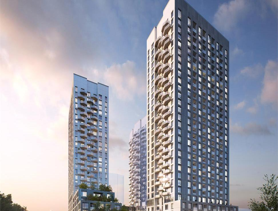 Full exterior rendering of 2 Abeja District Condos towers at dusk.