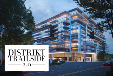 Rendering of Distrikt Trailside 2.0 Condos at night with logo overlay.