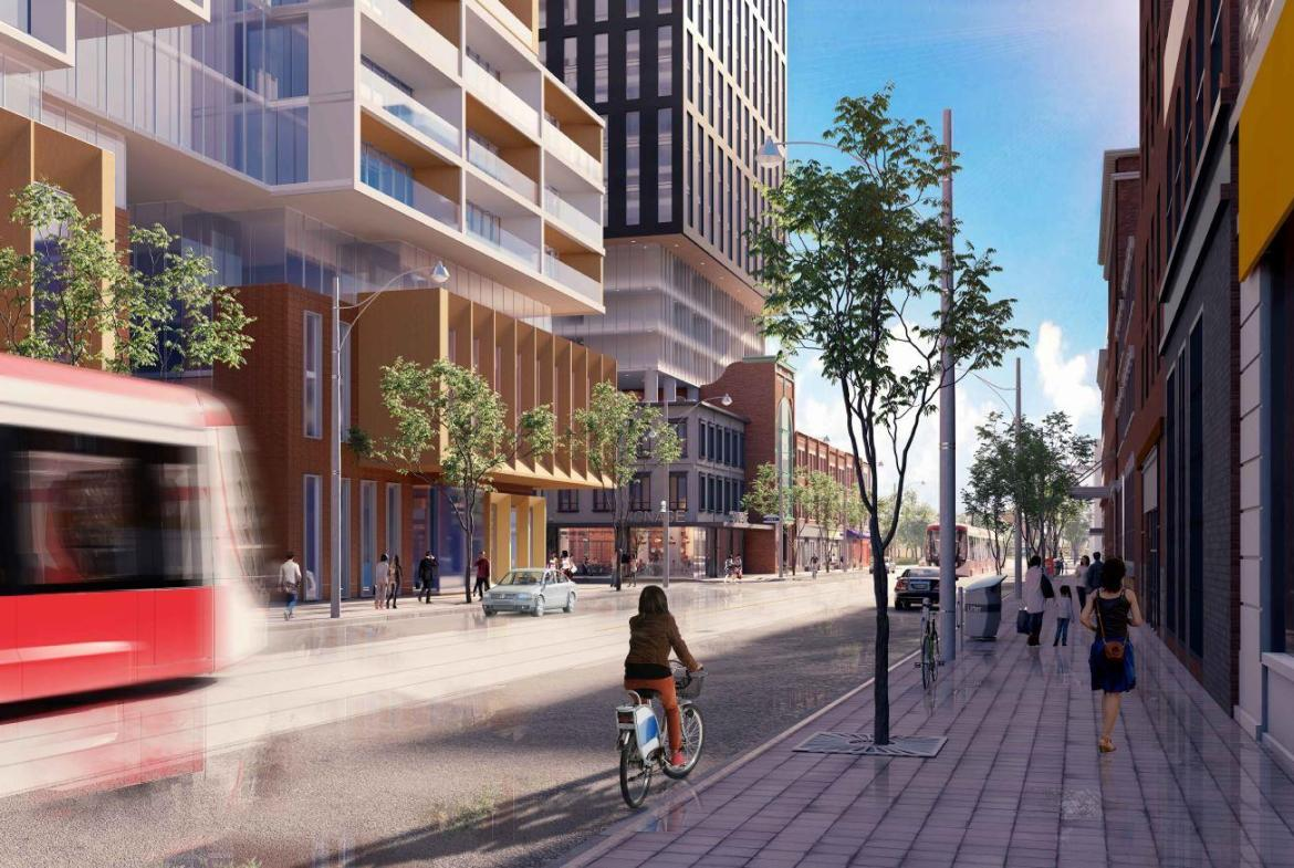 Rendering of street level with bike rider and street car passing 90 Queen Street East Condos.