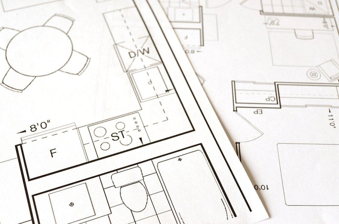 Paper with condo floor plans for client review.
