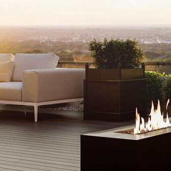 Beautiful condo rooftop terrace with fire feature and seating.