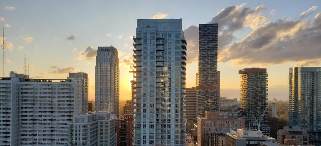 Toronto Condos in skyline with sun setting behind the buildings