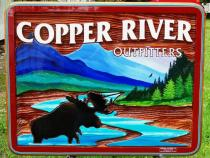 Copper River Outfitters,Smithers BC,Lanscape painting of mountains and moose on a custom made sandblasted cedar sign,busines sign of all kinds.Condor signs Vernon Bc