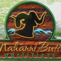 Nahanni Butte outfitters, sandblasted ceadar sign,Business signs,mountain sheep logo sand blasted into cedar for a custom sign,we ship anywhere,Condor signs Vernon BC