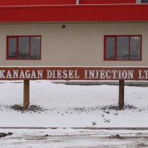 sand caeved /blasted log sign for okanogan diesel injection ltd. Vernon Bc