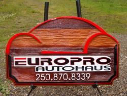 Europro Autohaus Kelowna BC committed to bringing you the highest quality work sandblasted cedar business sign