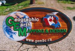 Geographic Earth Mapping and Design Vernon BC handcrafted cedar business sign sand blasted and artist painted