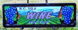 sand blasted cedar sign for pub,Monasee`s Vernon BC,Bc VQA wine seved here,live music,downtown veron,beer,pizza