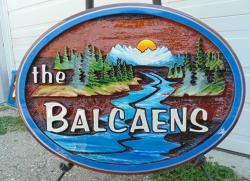 sand carved for the Balcaens in Armstong BC, cedar sign, artist painted, hand crafted by Condor Signs Vernon BC.