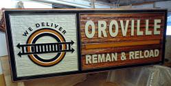 Ten foot long sand blasted cedar sign for Oroville Reman& Reload in Oroville Washington USA.