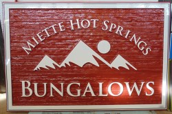 Large two sided sand blasted or san carved cedar wood sign for Miette Hot Springs Bungalows in Jasper National Park Alberts Canada by Condor Signs Vernon BC