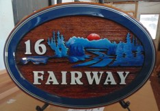 Cedar wood sign sandblasted and artist painted for house on golf course St. Albert Alberta Canada.Custom made by Condor signs/systems Vernon BC Canada