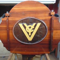 Vernon Yacht club back of sandblasted cedar sign after restoration by Condor Systems Vernon BC Canada