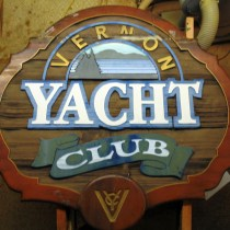 Vernon Yacht Club cedar wood sign before restoration by Condor signs Vernon BC Canada