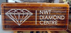 cedar wood sandblasted sign for De beers/hra group for the NWT Diamond Centre in yellow knife nt Canada.Another large sign custom made by Condor signs Vernon BC