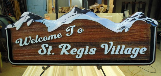 St Regis Village Hinton Alberta cedar sign sandblasted and painted by condor signs vernon bc