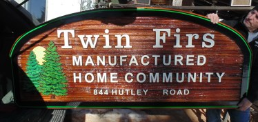 Delvelopment sign in sandblasted cedar for Twin Firs Manufactured Home Community Vernon BC by condor signs