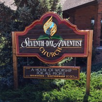 Seventh Day Adventist sanblasted cedarsign fully restored and installed by Condor Signs Vernon BC
