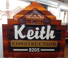 cedar sandblasted sign for Kieth Construction in Vernon BC custom made by Condor signs in Vernon BC