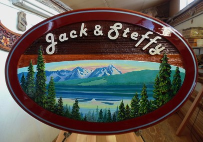 Smithers BC wood sign in sandblasted cedar.This ia a custom made artist painted sign by Condor systems Vernon BC