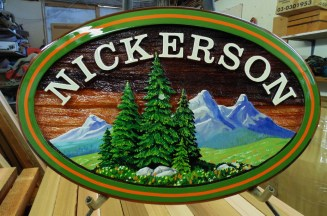 Family sign for Kamloops BC.Artist painted custom made and sandblasted in cedar By Condor signs Vernon BC