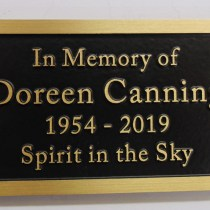 Bronze metal grave marker bench memorial plaque by Condor signs Vernon BC.