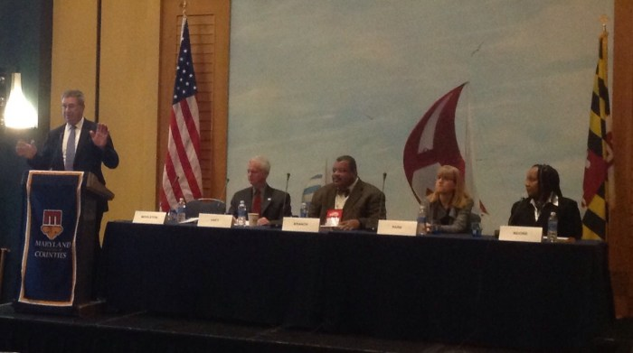 Senator Middleton introduces the panelists for the Power and Perils of Public Health general session.