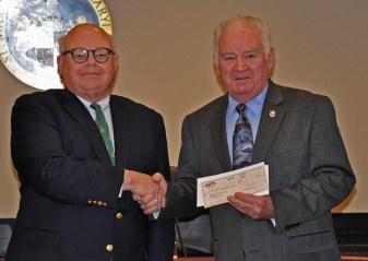 LGIT Executive Director Timothy Ailsworth (left) presents LGIT Training Grant $5,860 Award check to Commissioner President Randy Guy, Courtesy of St. Mary's County Public Information Office