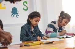 two girls doing school works