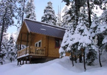 hunting log cabin in the snow