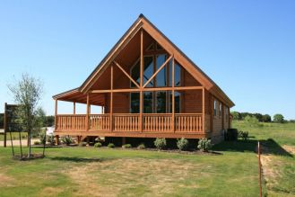 log house with prowl glass windown