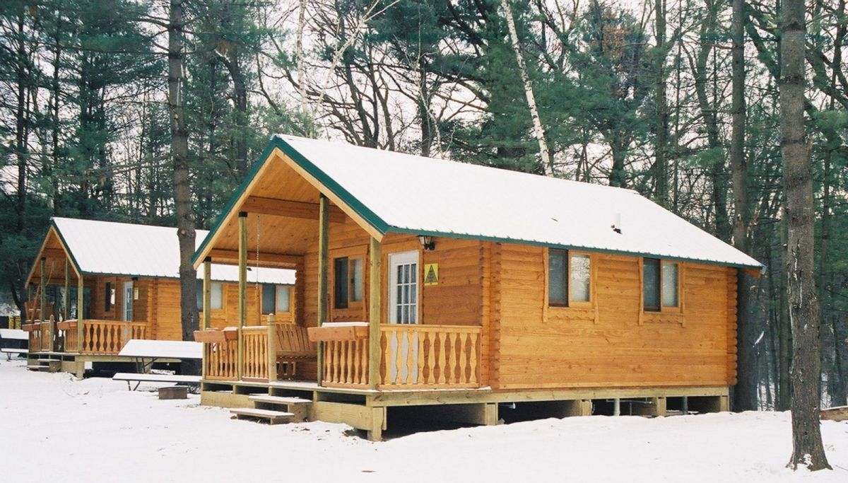 camp log cabins in snow
