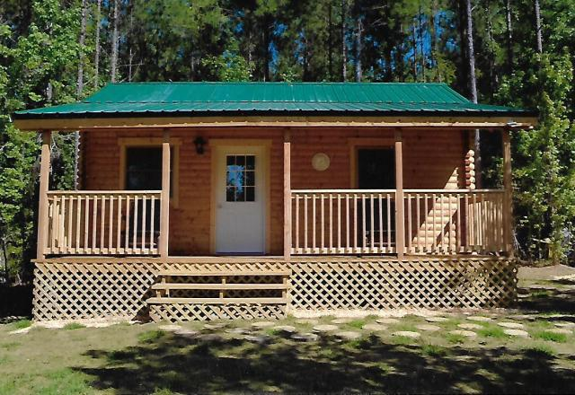 Log cabins structures kits small affordable for Camping cabin kits