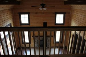 log home loft view of fireplace