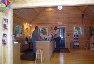 Trap Pond log building interior sales desk