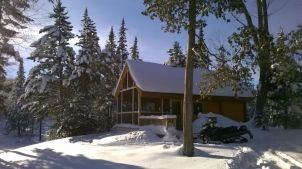 Outdoorsman Conestoga log cabin in Vermont with snow