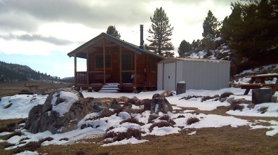 Serenity log cabin model in winter with bear proofing