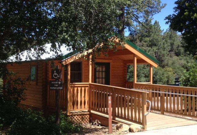 Resort camping cabin kits conestoga log cabins homes for Camping cabin kits