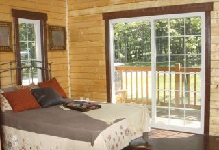 Sugarloaf log home kit bedroom to deck