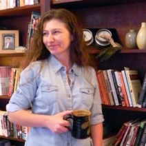tara caimi holding mug in frong of shelf