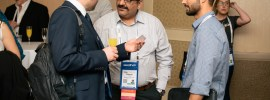 Giving out business cards at Affiliate Summit
