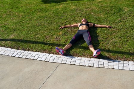 Tired Runner Laying on Grass
