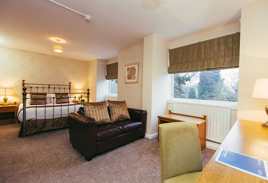 Double bedroom with sofa at Lucas House Hotel